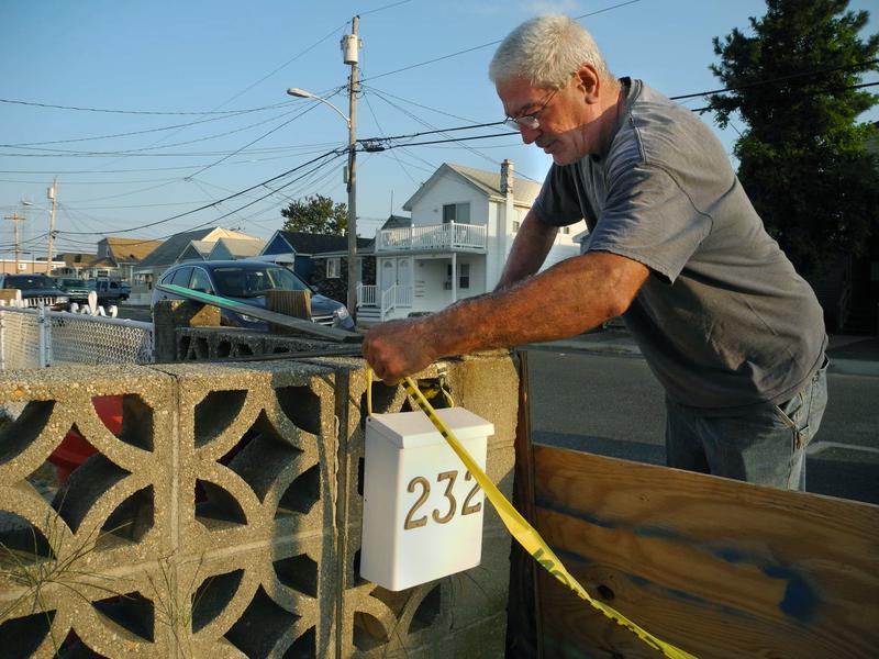 Lambros Vlachakis checking his mailbox