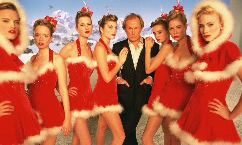 """Bill Nighy as Billy Mack with Video Vixens in """"Love Actually"""""""