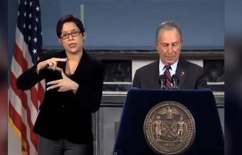 Lydia Callis doing ASL interpretation during a Mayor Bloomberg Sandy briefing.