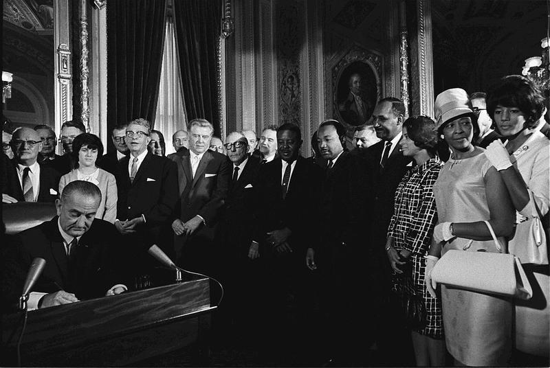 President Lyndon Johnson signs the Voting Rights Act in 1965.