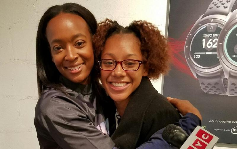 Bryann Sandy (right), a high school sprinter from Brooklyn, hugs her idol, Dalilah Muhammad, formerly of Queens and the reigning Olympic champ in the 400 meter hurdles.