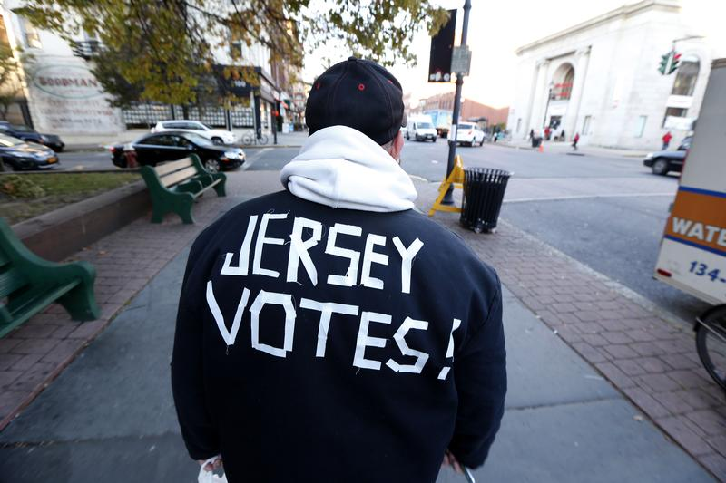 A man wears a message on his jacket on Election Day while walking home, Tuesday, Nov. 6, 2012, in Hoboken, N.J.