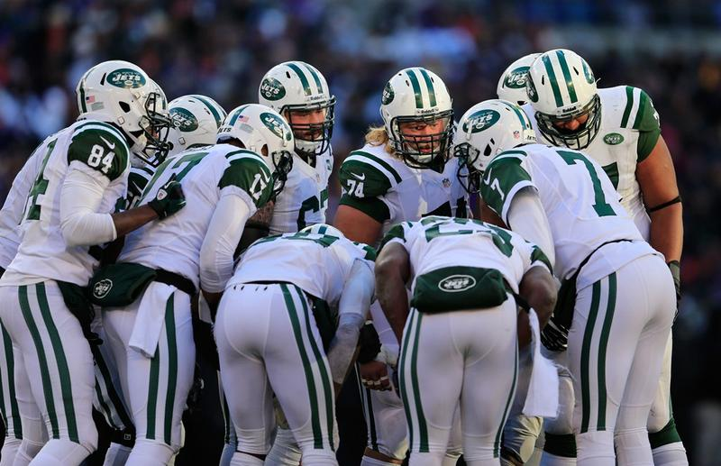 Members of the New York Jets offense gather in the huddle during the fourth quarter of their 19-3 loss to the Baltimore Ravens at M&T Bank Stadium on November 24, 2013 in Baltimore, Maryland.