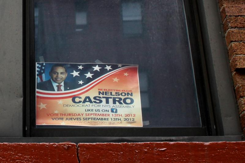 Assemblyman Nelson Castro's reelection 2012 posters still hang in windows in the Fordham Heights section of the Bronx, after his resignation.