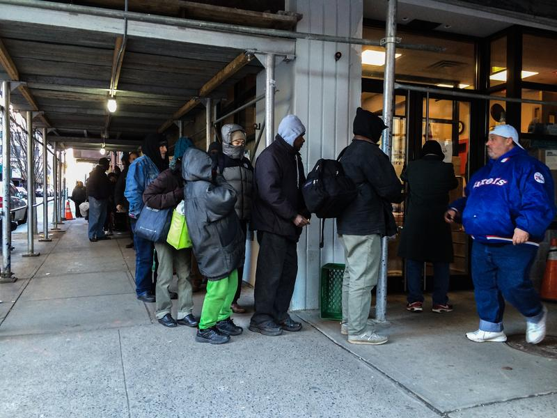 Crowds lined up outside of the New York City Rescue Mission on Christmas Day for the annual coat drive and free food.