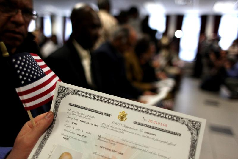 Newest Americans at naturalization ceremony for immigrants to America in New York City.
