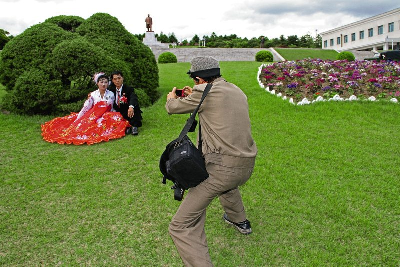 A bride and groom in Kaesong pose for a wedding photo. From North Korea: Anonymous Country by Julia Leeb.