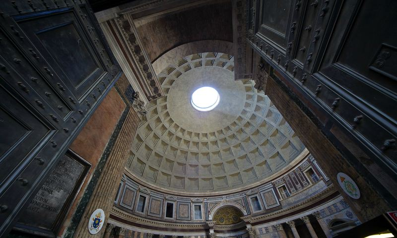 """The Pantheon in Rome features an oculus: a circular opening, or """"eye,"""" that allows natural light into the interior of the structure's dome"""