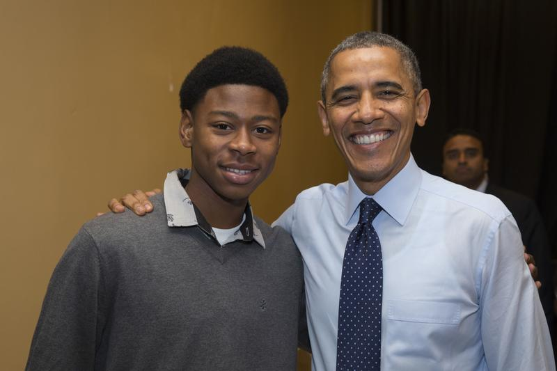 President Barack Obama back stage with Radcliffe Saddler before remarks at the Pathways in Technology Early College High School on Oct. 25, 2013.