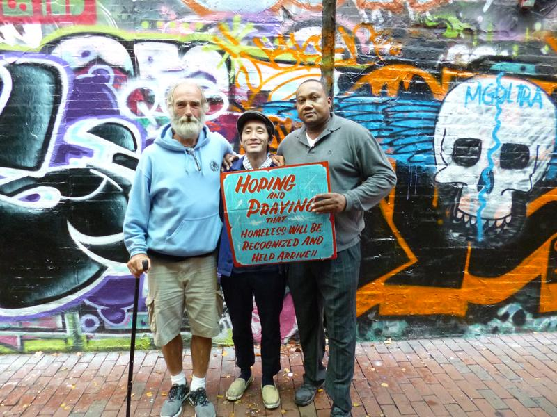 On the left is Mike Lehman and in the middle is artist Kenji Nakayama, who started the project. On the right is Dana Robinson, who has been homeless for 3 years.