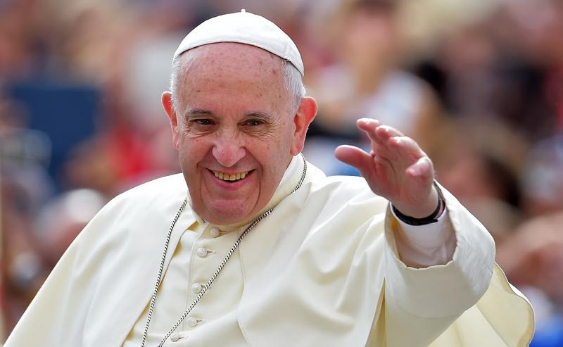 Pope Francis waves to faithful upon his arrival on St. Peter's square at the Vatican to lead his weekly general audience on September 16, 2015.