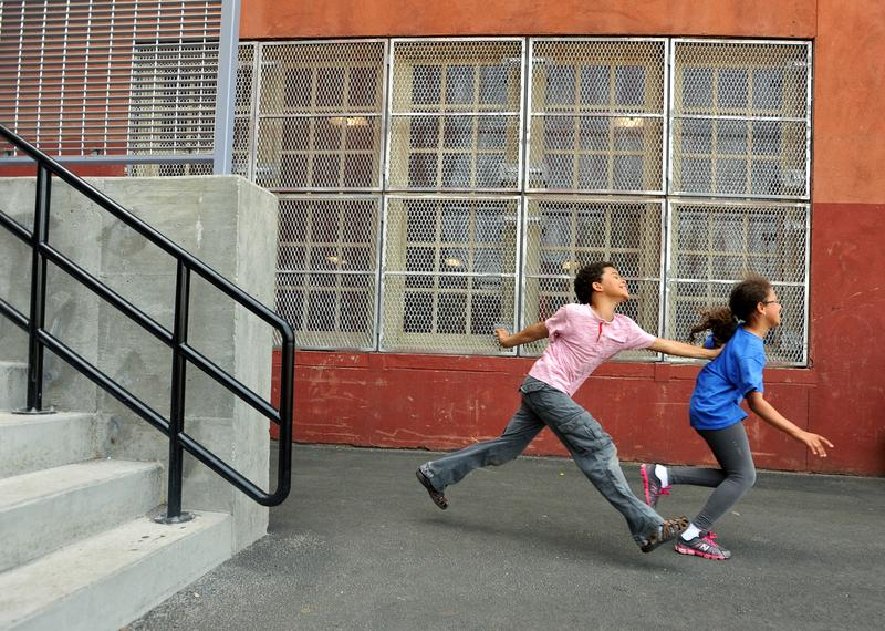 Third grader Q Daily tags classmate Valery Serrano at recess at The Brooklyn New School.