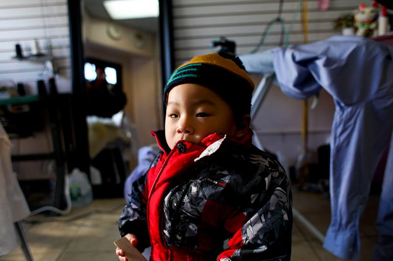 Raymond Yu, 1, whose mother owns a dry cleaners in the Rockaways where heat and electricity have yet to be restored.