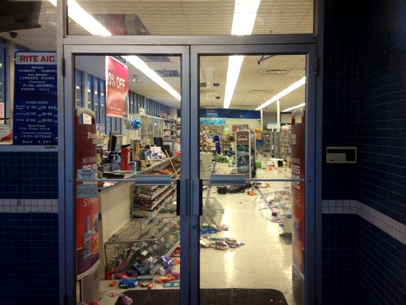 The Rite Aid in East Flatbush, Brooklyn was badly damaged after dozens stormed it following a vigil for a slain teen.