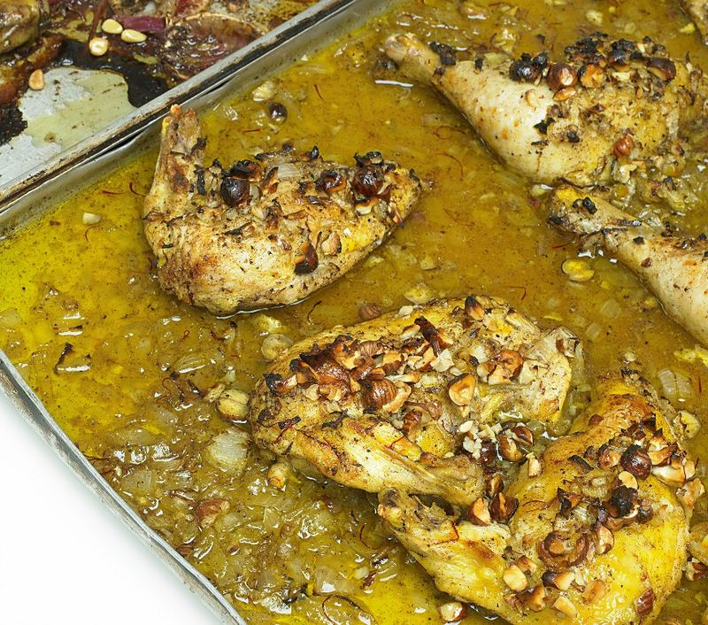Roast chicken with saffron, from Ottolenghi: The Cookbook by Yotam Ottolenghi & Sami Tamimi, copyright © 2013. Published by Ten Speed Press, a division of Random House, Inc.