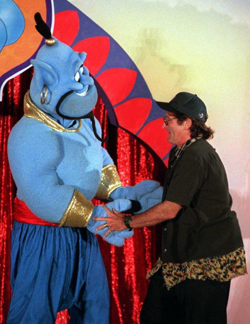 Robin Williams dances with the Disney character 'Genie' in Los Angeles in 1996.