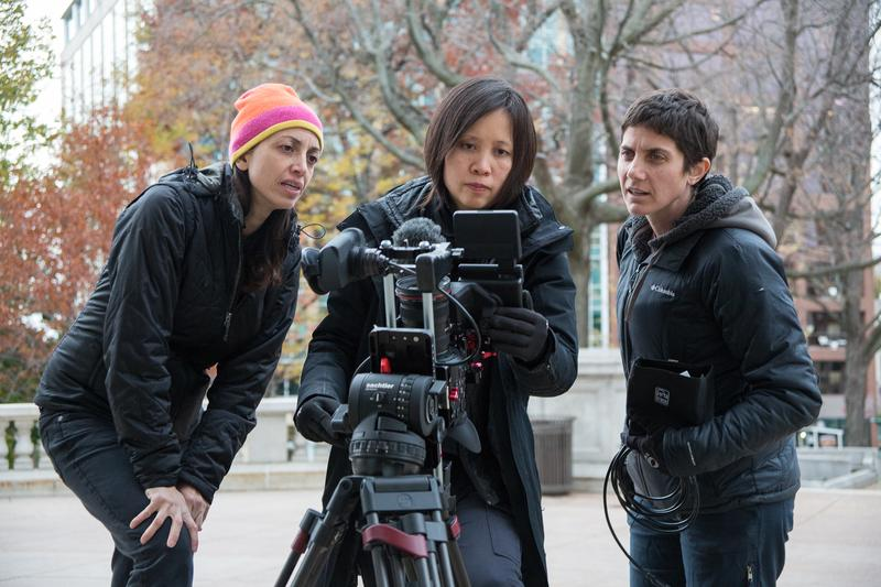 Laura Ricciardi (left) and Moira Demos (right) talk over a shot with cinematographer Iris Ng.