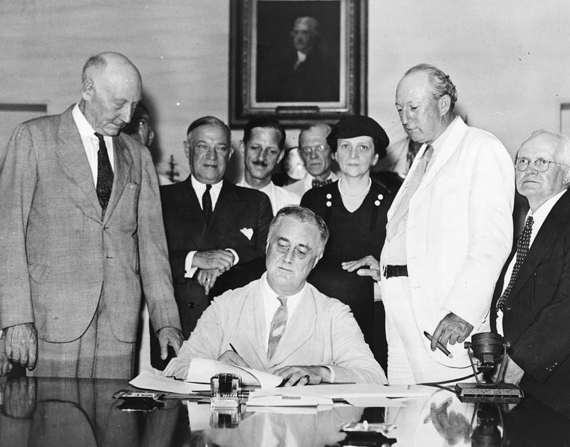 President Franklin Delano Roosevelt signs the Social Security Act on August 14, 1935
