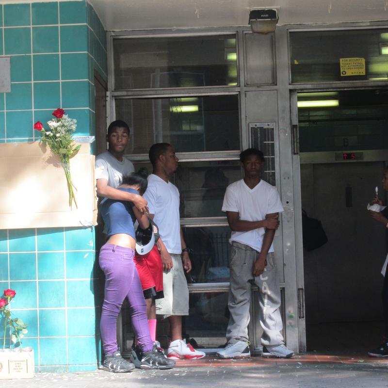 Friends mourn the teen shot by police outside his apartment.