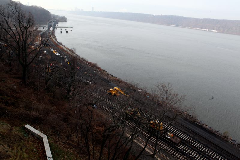 Crews repairing tracks on Tuesday, Dec. 3, 2013,  at the site of Sunday's Metro-North fatal train derailment.