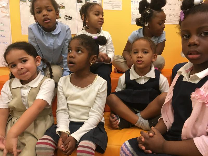 Students wait for story time at Little Scholars Early Development Center in the South Bronx.