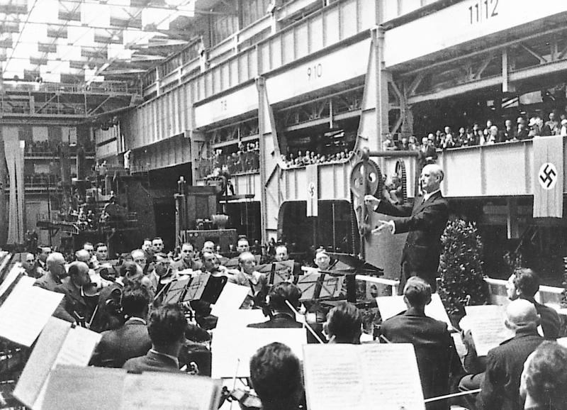 Wilhelm Furtwangler & the Vienna Philharmonic at an armaments factory in Berlin in May 1943
