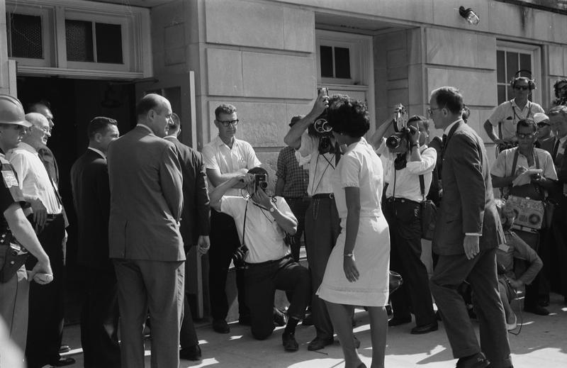 Vivian Malone, accompanied by Deputy U.S. Attorney General Nicholas Katzenbach, enters the University of Alabama to register for classes.