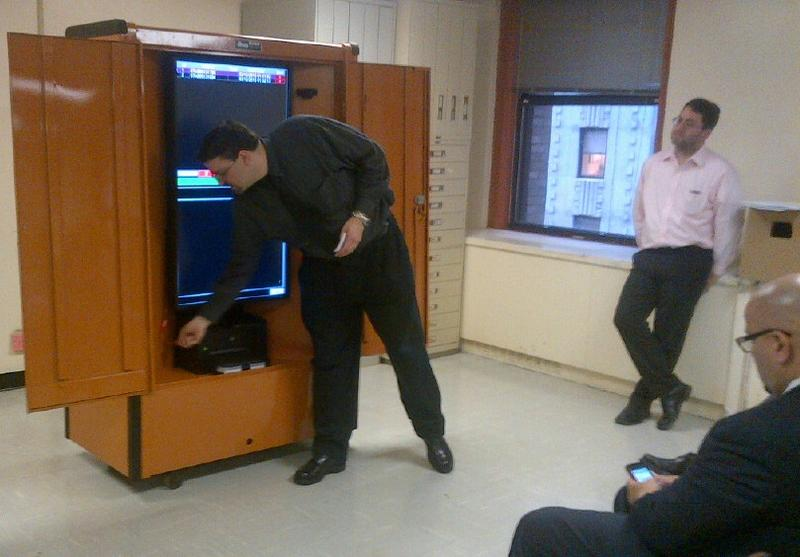 "John Naudus of New York City Board of Elections demonstrates the new ""voter kiosk"" at meeting of commissioners March 12, 2013."