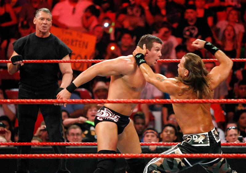 World Wrestling Entertainment Inc. Chairman Vince McMahon watches wrestlers Ted DiBiase and Shawn Michaels compete during the WWE Monday Night Raw show in Las Vegas, August 24, 2009.