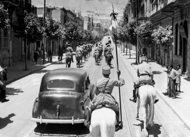 Free French troops enter the town of Damascus, Syria on July 22, 1941. Car containing General Catroux and General Les Gentilhommes with their escort of Cirassian cavalry going through the town.