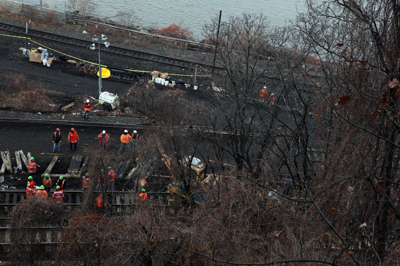 Crews repairing tracks in the Bronx on Tuesday, Dec. 3, 2013,  at the site of Sunday's Metro-North fatal train derailment.