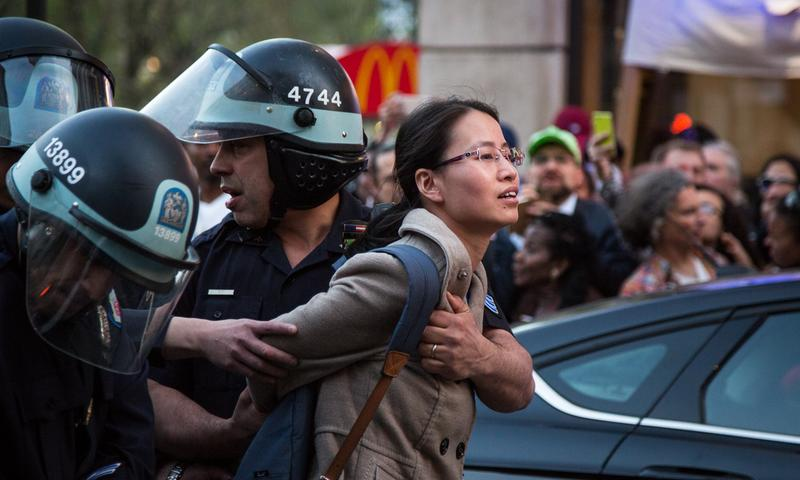 A woman is arrested during a demonstrations near Union Square on April 29, 2015.