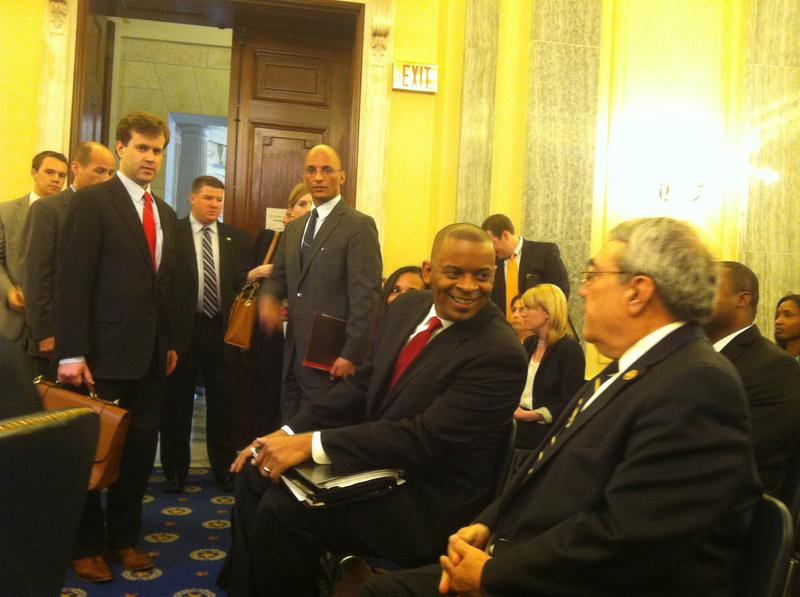 Anthony Foxx (seated; red tie) at his Senate confirmation hearing