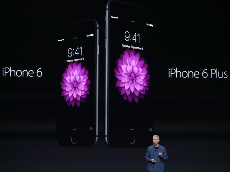Apple CEO Tim Cook announces the iPhone 6 and iPhone 6 Plus at the Flint Center in Cupertino, Calif., Tuesday.
