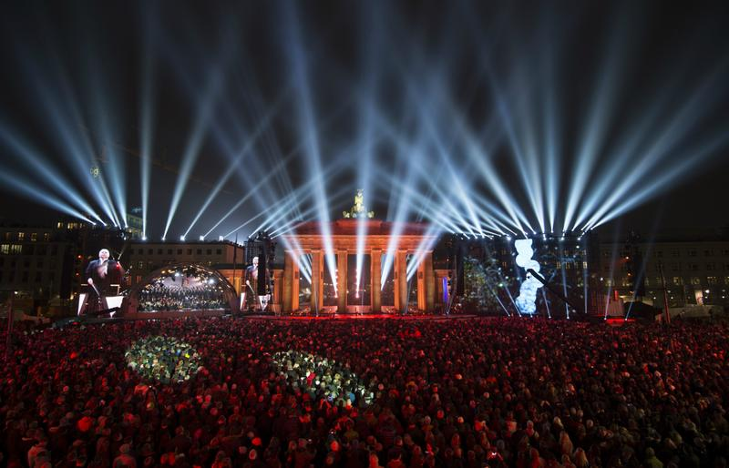 A screen shows conductor Daniel Barenboim during a Street Party to mark the 25th anniversary of the fall of the Berlin Wall, in front of the Brandenburg Gate