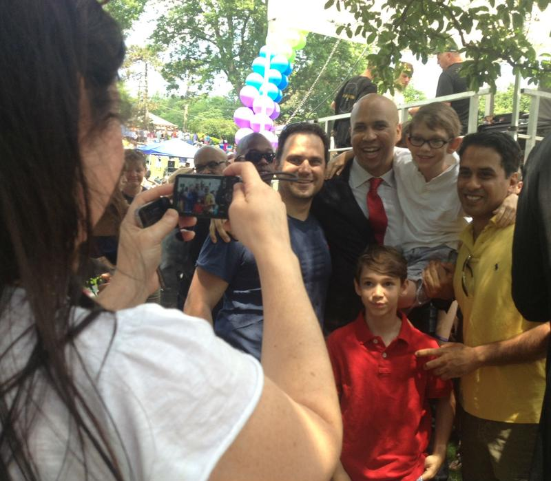 The day after announcing his U.S. Senate run, Newark Mayor Cory Booker was swarmed by supporters at North Jersey Pride in Maplewood.
