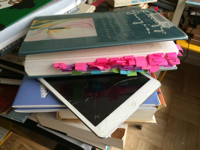 When Maria Popova, editor of Brainpickings.org, can't read a book on the iPad, she uses an elaborate system of sticky tabs and a hand written index. This is her desk.