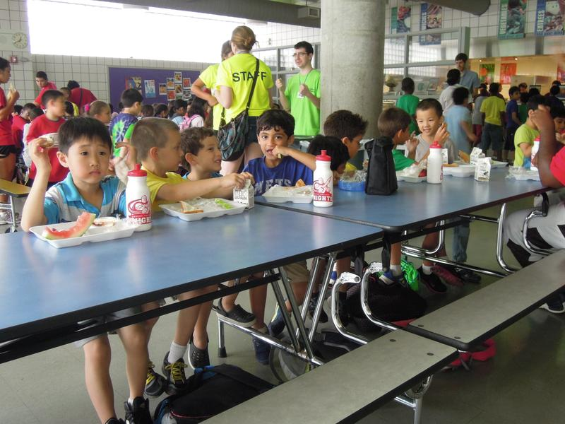 Students in a summer camp eat lunch at P.S./I.S. 499 in Queens.