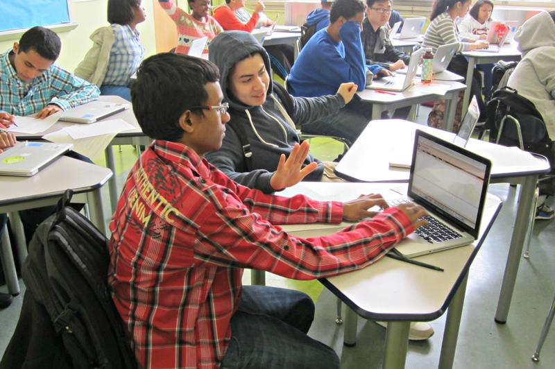 Freshmen students work in a data functions class at the Academy for Software Engineering.