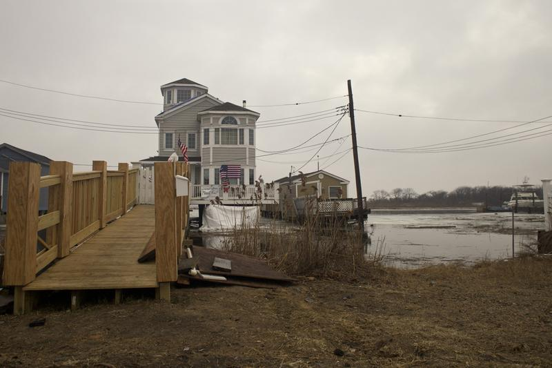 Living on the water in Broad Channel, Queens means repairing your private gangway to get to shore from your house after Sandy.