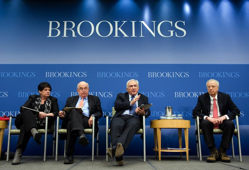 Former IMF Managing Director Dominique Strauss-Kahn, center right, at the Brookings Institute, Wednesday April 13, 2011 in Washington, D.C.