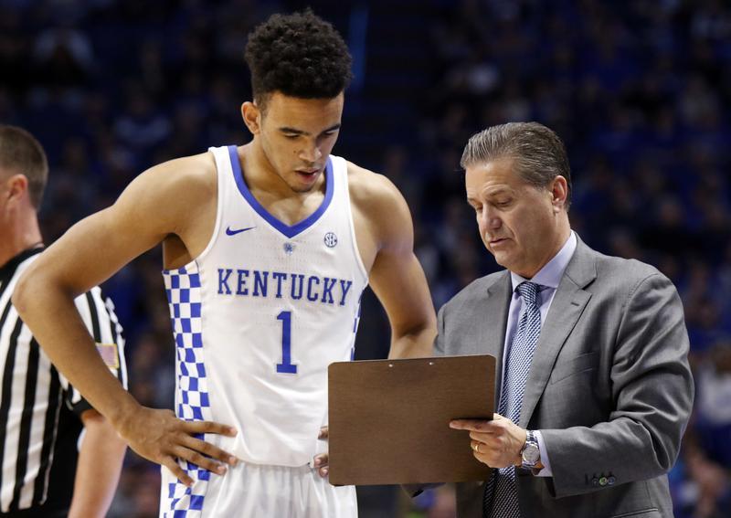 Kentucky's Sacha Killeya-Jones (1) receives instruction from head coach John Calipari during the second half of an NCAA college basketball game against Canisius, Sunday, Nov. 13, 2016.