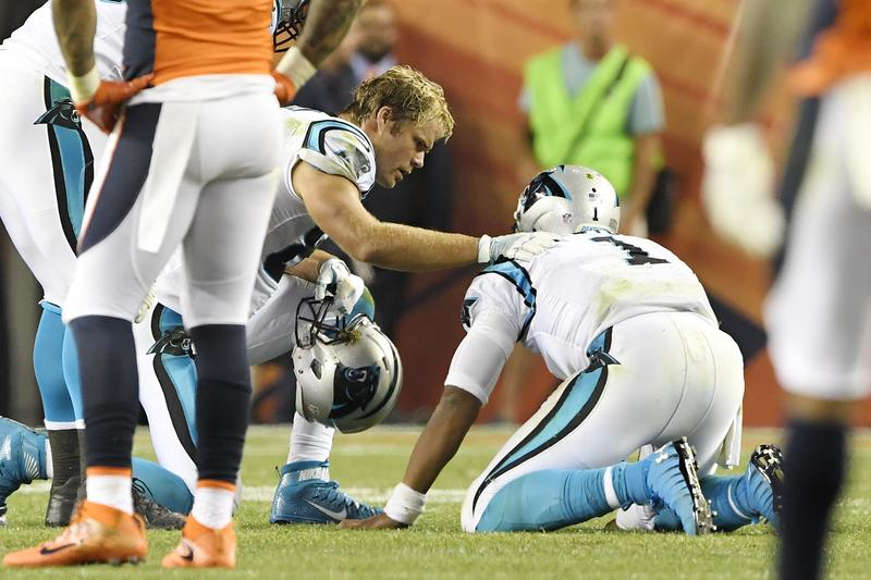 Greg Olsen (88) of the Carolina Panthers checks the health of his quarterback Cam Newton (1) after he got leveled in the Panthers' season opener on September 8.
