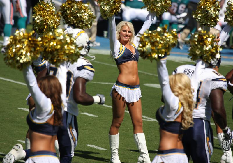 San Diego Chargers player running through the Chargers Cheerleaders