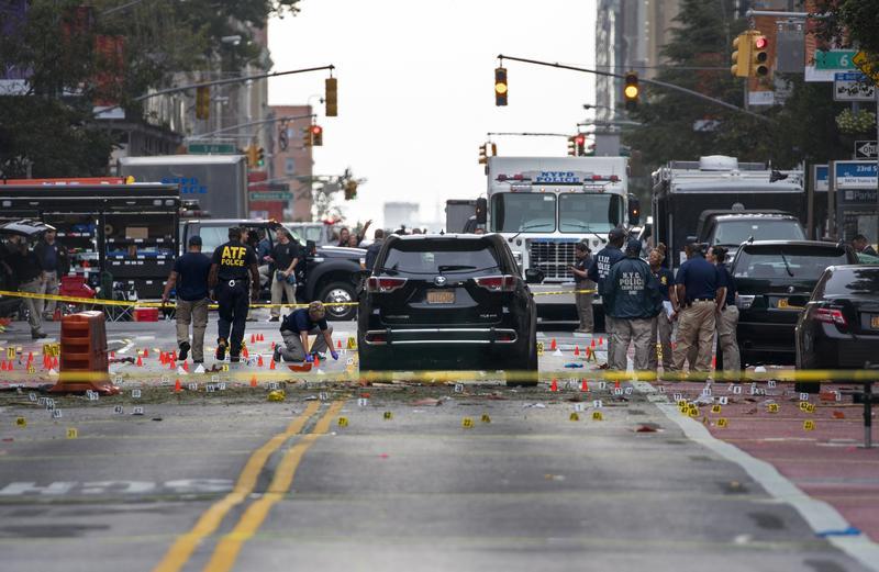 Crime scene investigators work at the scene of an explosion on West 23rd St. in Manhattan, Sunday, Sept. 18, 2016.