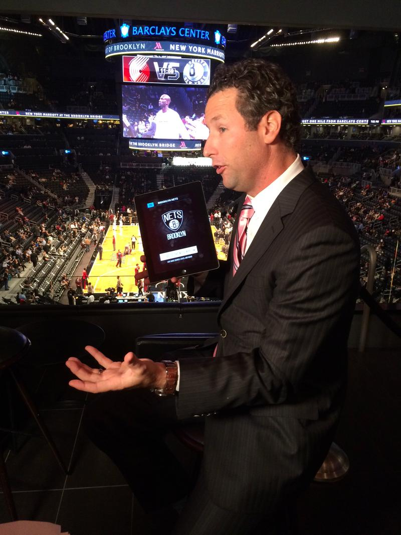 Chip Foley, Vice President of Technology at the Barclays Center, demonstrates how to watch live video and replays on the arena's app.