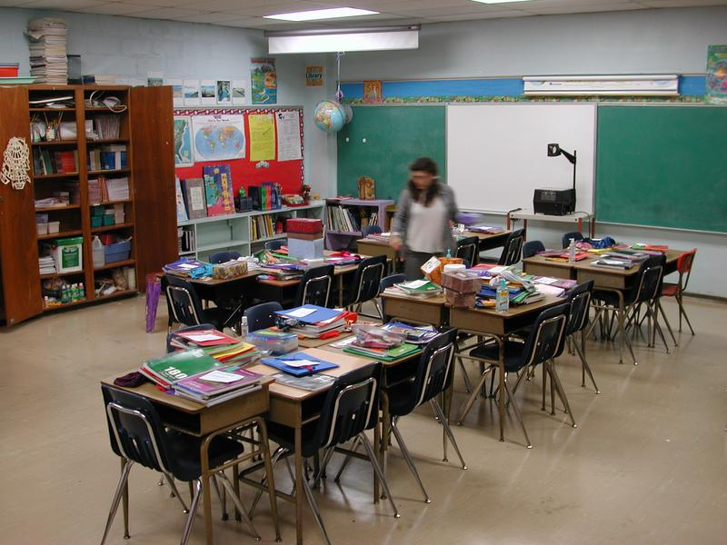 A teacher readying her classroom for the first day of school.