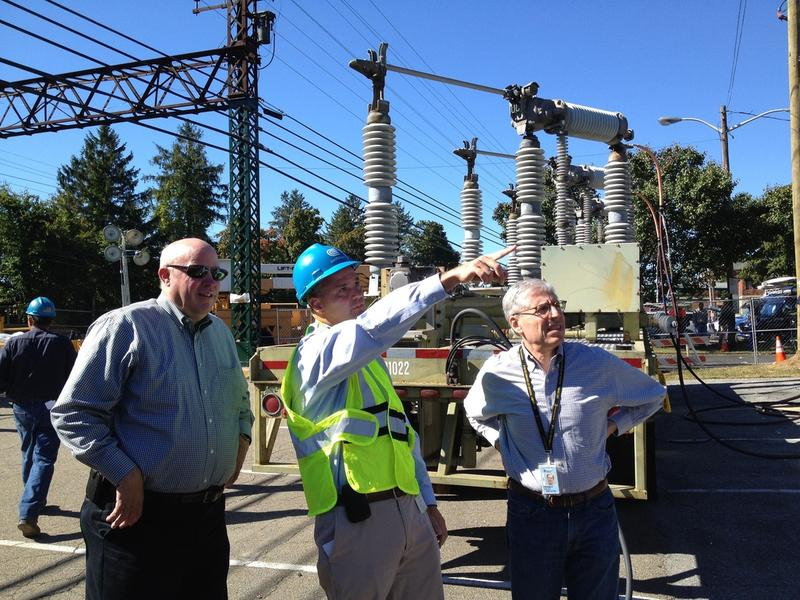 MTA chair Tom Prendergast, Con Edison VP Tim Cawley and Metro-North Railroad president Howard Permut (l-r) view Con Edison's temporary substation under construction at the Harrison Metro-North Station