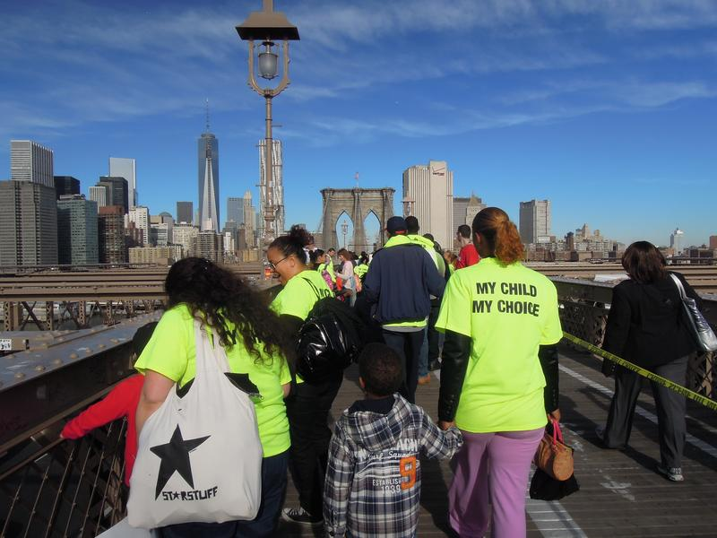 Charter supporters cross the Brooklyn Bridge in October in a march organized by Families for Excellence in Schools.