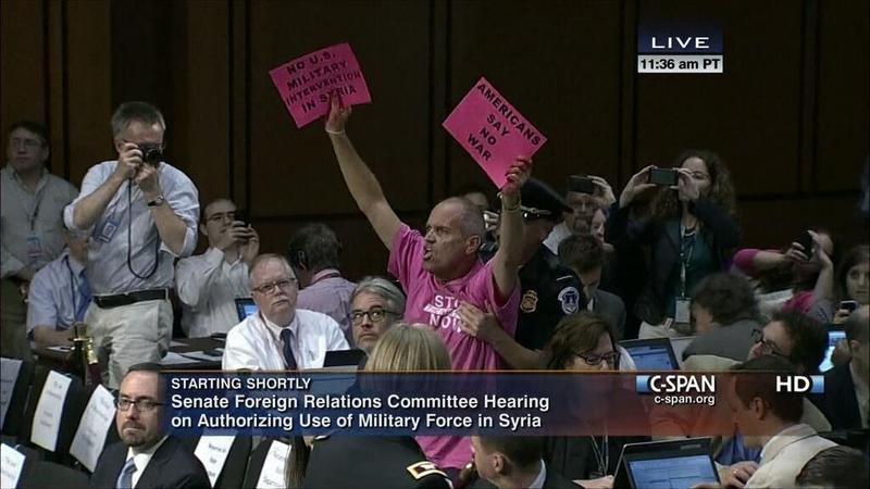 Prior to the start of the hearing on authorizing use of military force in Syria, a Code Pink protester at the Senate Foreign Relations Committee.